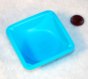 Blue mixing boat and penny for size