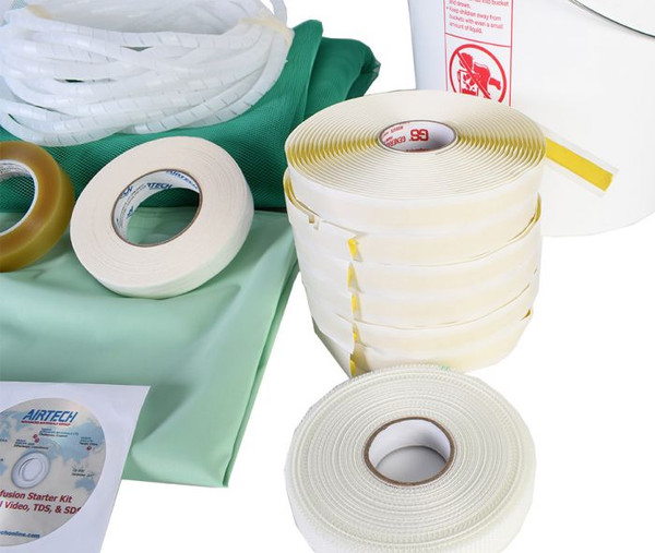 Close Up of Tapes, bucket, tubing, and DVD on green bags